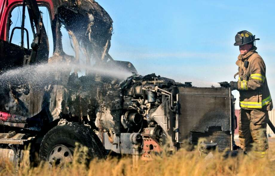 A truck traveling east on I-20 caught on fire after striking a guardrail Friday. The driver was able to escape from the vehicle. James Durbin/Reporter-Telegram Photo: JAMES DURBIN
