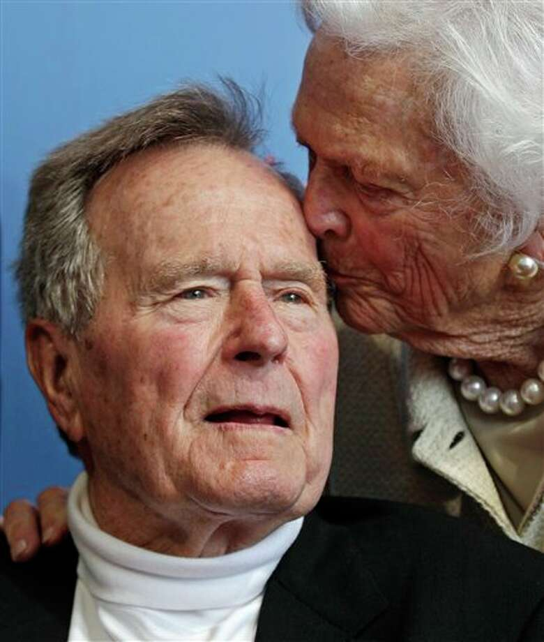 FILE - In a Tuesday, June 12, 2012 file photo, former President George H.W. Bush, and his wife former first lady Barbara Bush, arrive for the premiere of HBO's new documentary on his life near the family compound in Kennebunkport, Maine. Former President Bush has been hospitalized for about a week in Houston for treatment of a lingering cough. Bush's chief of staff, Jean Becker, says the 88-year-old former president is being treated for bronchitis at Houston's Methodist Hospital and is expected to be released by the weekend. He was admitted Friday, Nov. 23, 2012. (AP Photo/Charles Krupa, File) Photo: Charles Krupa / A2012