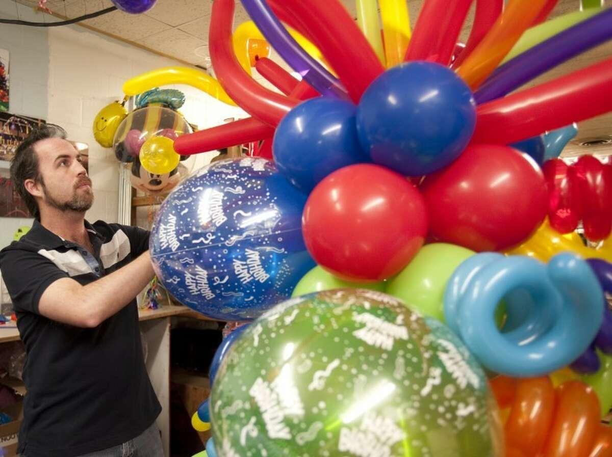 Cody Williams makes balloon masterpieces at Mark Knox Flowers in Odessa. Tim Fischer\Reporter-Telegram