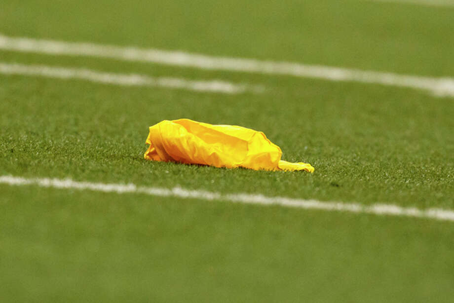 Penalty flag on the field during an NFL football game between the Detroit Lions and the Chicago Bears in Detroit, Monday, Oct. 10, 2011. (AP Photo/Rick Osentoski) Photo: Rick Osentoski / Rick Osentoski