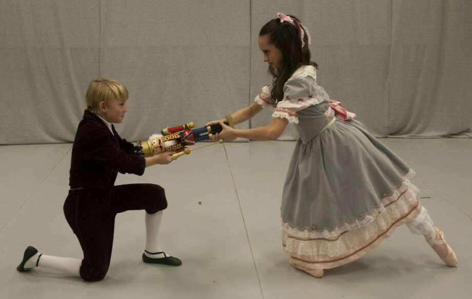 Adin Watson, as Fritz, fights with Zoe Segura, as Clara, over the Nutcracker during rehearsal for Midland Festival Ballet's Nutcracker. Tim Fischer\Reporter-Telegram Photo: Tim Fischer