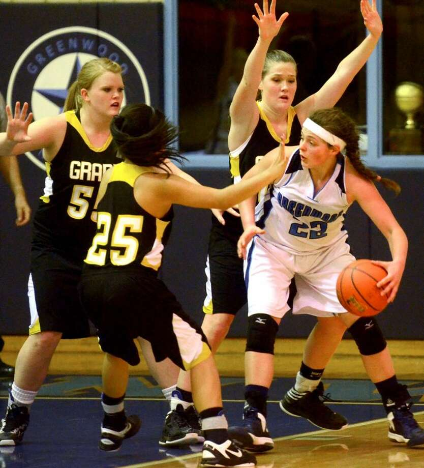 Greenwood's Amanda Bell gets pressured by the Grady defense in the final game of the Rangerette Shootout Saturday at Greenwood High. Grady beat Greenwood 54-52. James Durbin/Reporter-Telegram Photo: JAMES DURBIN