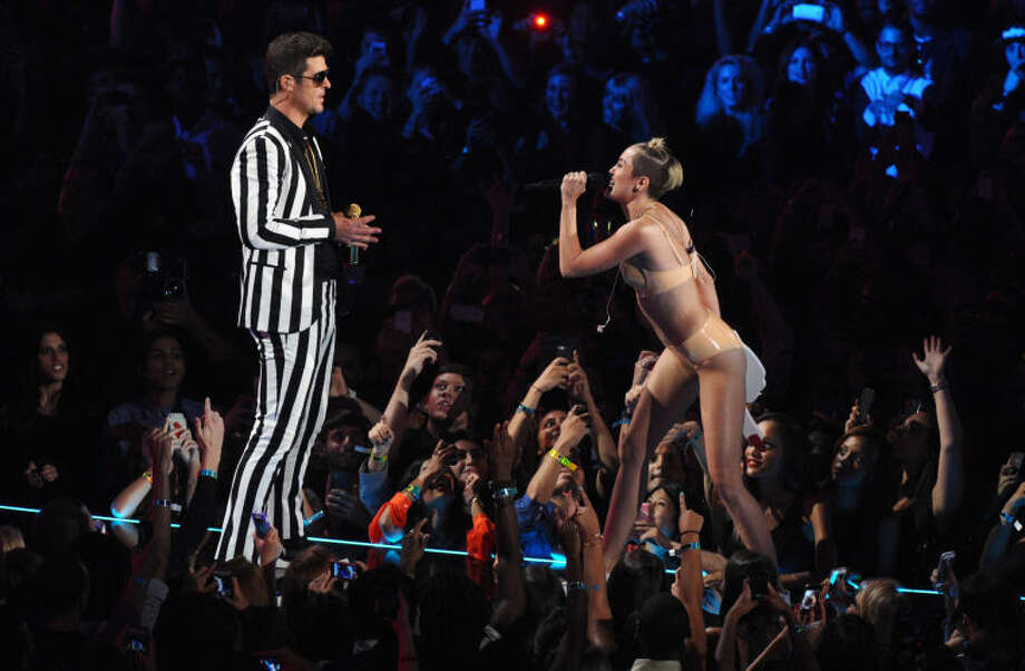 "Robin Thicke, left, and Miley Cyrus perform ""Blurred Lines"" at the MTV Video Music Awards on Sunday, Aug. 25, 2013, at the Barclays Center in the Brooklyn borough of New York. (Photo by Charles Sykes/Invision/AP) Photo: Charles Sykes"
