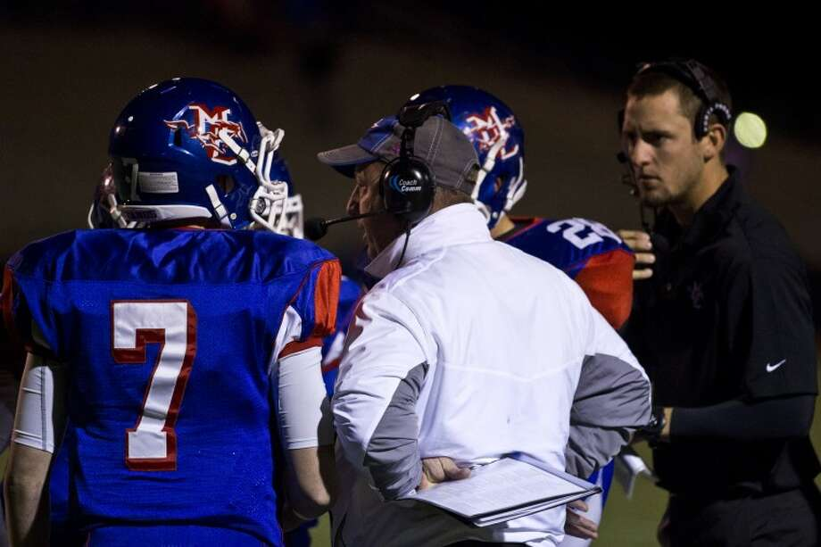 Coach gives his teammates encouragement during the game between Midland and Parish Episcopal Photo: Matthew Sewell