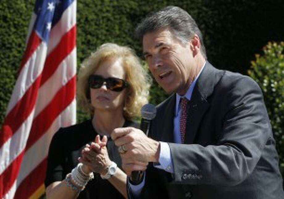 Texas Gov. Rick Perry, right, speaks as his wife Anita looks on during a Republican Party of Orange County rally at Roger's Gardens in Newport Beach, Calif., Thursday, Sept. 8, 2011. Photo: (AP Photo/Chris Carlson)