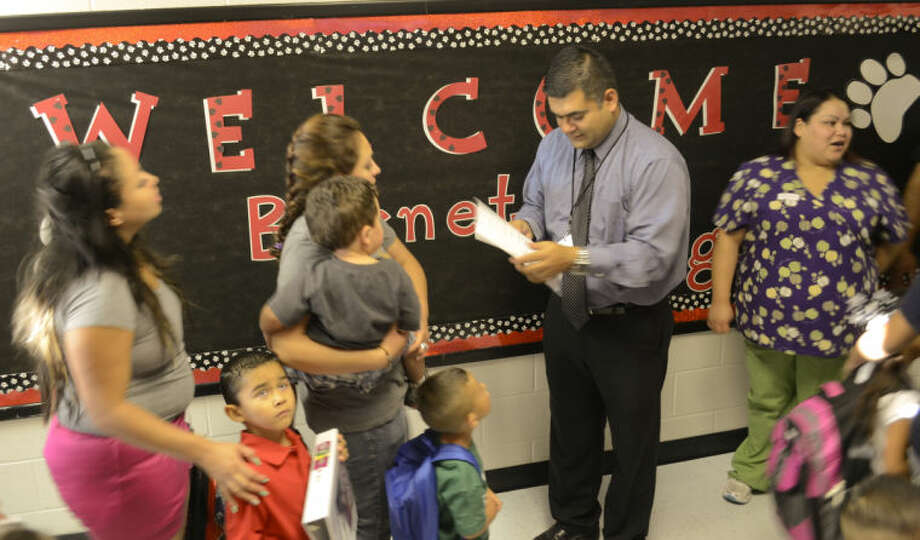 Alex Salazar, principal for Burnet Elementary and first year with MISD, greets students and parents Monday morning on the first day of school. Tim Fischer\Reporter-Telegram Photo: Tim Fischer