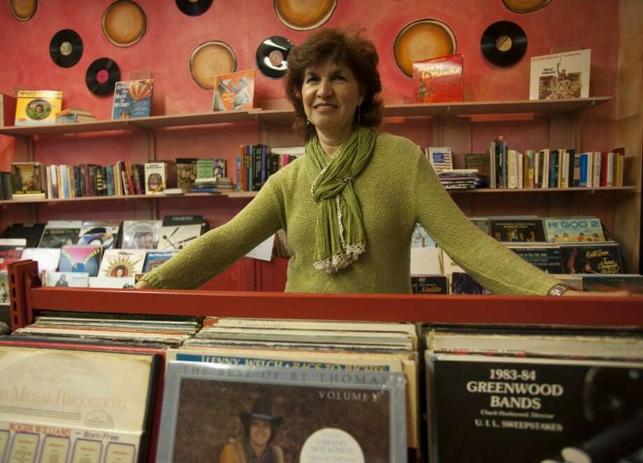 Grace Aguilar, president of Friends of the Library, shows off the newly designed record room in Friends of the Library. Tim Fischer\Reporter-Telegram Photo: Tim Fischer