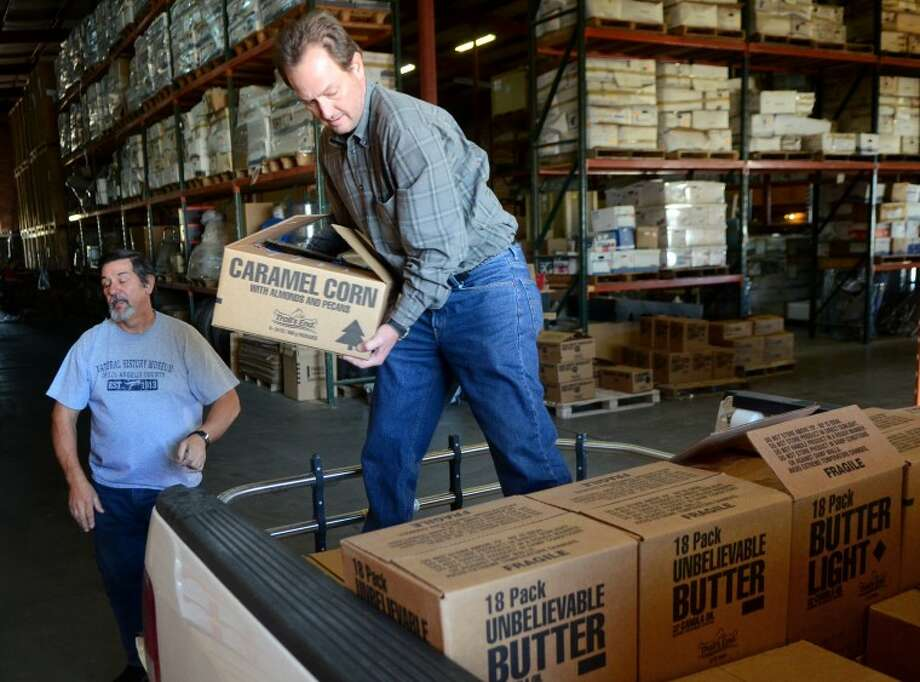 Blake Baylor, the official 'popcorn chairman' for Pack 641 in Midland, loads popcorn into his truck Wednesday at the Rocky Ford warehouse. Pack 641 raised $22,272 as part of their annual fundraising efforts. The Boy Scout groups in all 18 counties of West Texas raised a total of $400,000 this year. James Durbin/Reporter-Telegram Photo: JAMES DURBIN