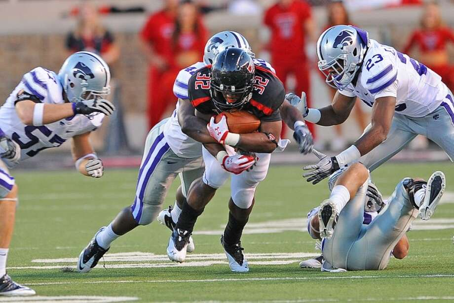 Texas Tech running back Aaron Crawford is smothered by the Kansas State defense in Saturday night Big XII action. The Wildcats remained undefeated as they held on to beat the Red Raiders 41-34. Photo: Wade H Clay