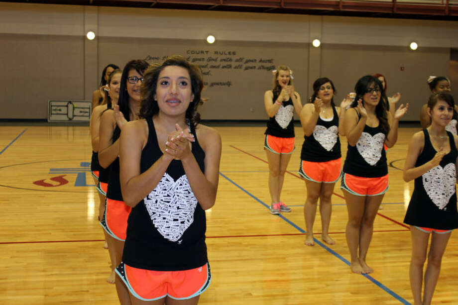 Amanda Franca, an officer of the Midland High School Starz dance team, leads her squad line in the school fight song during practice Friday morning in the First Presbyterian Church gymnasium. The 25-member dance team was selected to attend the UDA National Dance Team Championships Feb. 1-2 at the World Disney World Resort in Orlando. Meredith Moriak/Reporter-Telegram