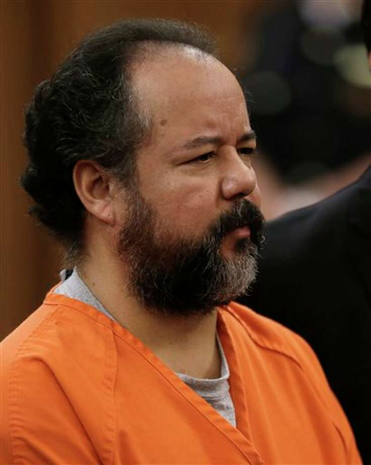 FILE - This Wednesday, July 17, 2013 file photo shows Ariel Castro standing before a judge during his arraignment on an expanded 977-count indictment in Cleveland. Castro, who held 3 women captive for a decade, has committed suicide, Tuesday, Sept. 3, 2013. (AP Photo/Tony Dejak, file) Photo: Tony Dejak / AP