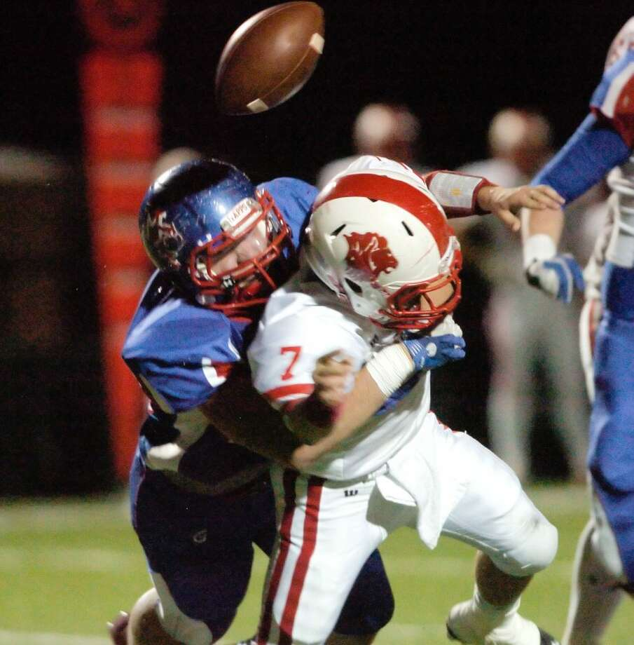 Payton Ray sacks Grapevine Faith Christian quarterback Jared Pruett causing him to fumble the ball Friday at Mustang Field. Cindeka Nealy/Reporter-Telegram Photo: Cindeka Nealy