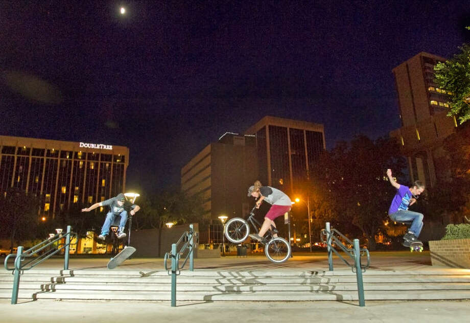 Three Midland teens enjoy a clear night of skating in Centennial Plaza on Thursday. James Durbin/Reporter-Telegram Photo: JAMES DURBIN