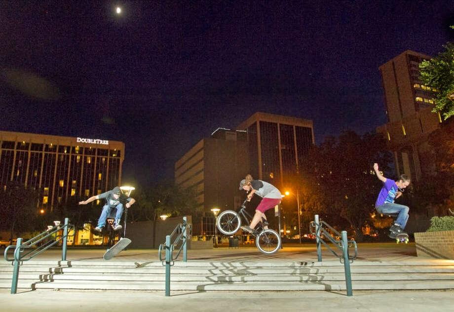 Three Midland teens enjoy a clear night of skating in Centennial Plaza on Thursday. James Durbin/Reporter-Telegram Photo: JAMES DURBIN