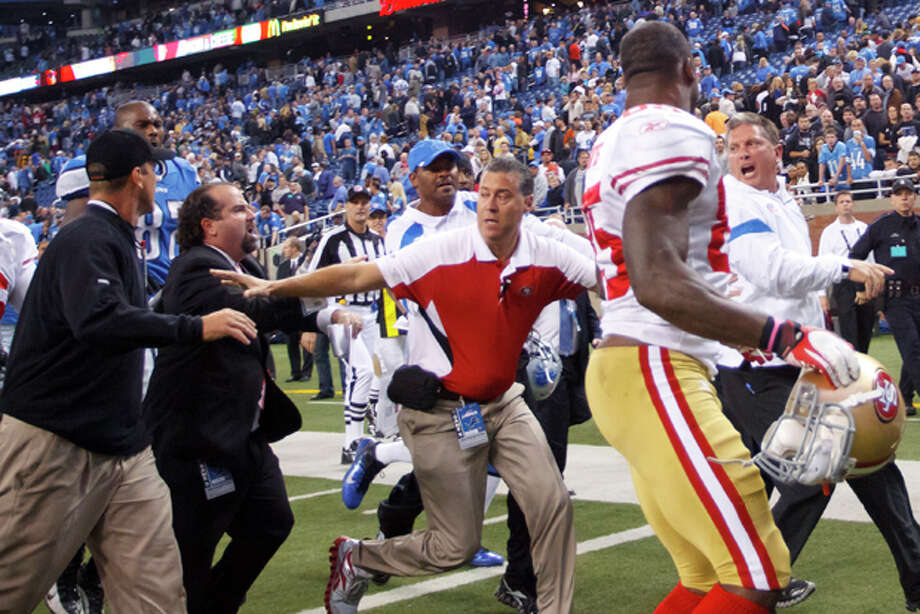San Francisco 49ers head coach Jim Harbaugh, left, and Detroit Lions head coach Jim Schwartz, right, shout at each other after an NFL football game in Detroit, Sunday, Oct. 16, 2011. The 49ers won 25-19. (AP Photo/Rick Osentoski) Photo: Rick Osentoski / Rick Osentoski