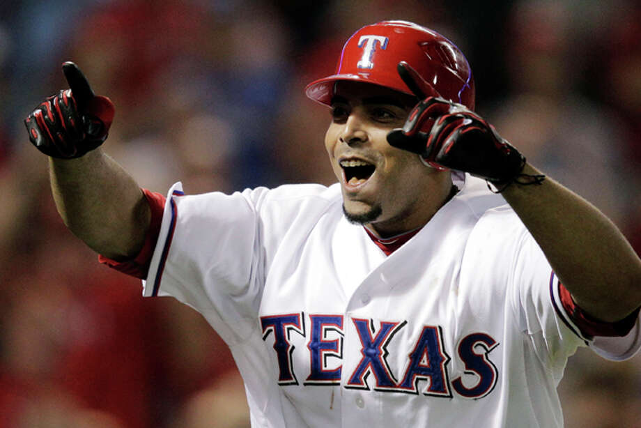 The Texas Rangers' Nelson Cruz reacts after hitting a two-run home run against the Detroit Tigers during the seventh inning at Game 6 of baseball's American League championship series Saturday, Oct. 15, 2011, in Arlington, Texas. (AP Photo/Charlie Riedel) Photo: Charlie Riedel / AP