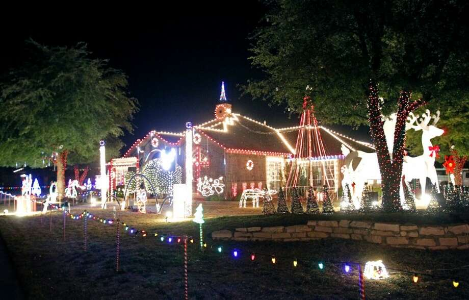 The Thames Family home boasts holiday cheer in the form of 55,919 lights, as well as displays of music and Christmas decorations. James Durbin/Reporter-Telegram Photo: JAMES DURBIN