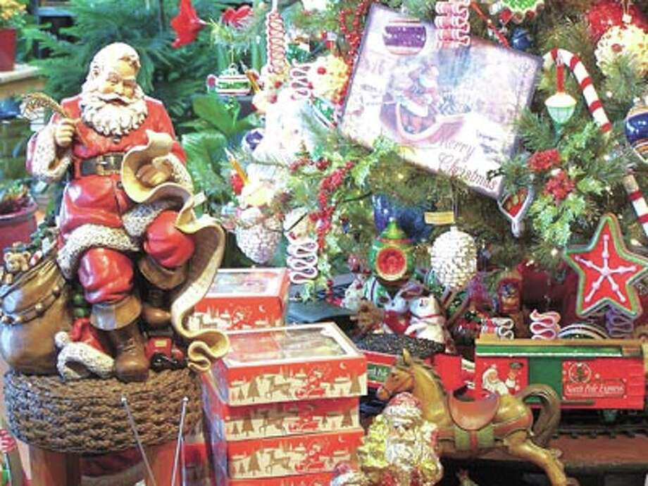 Working on his list, Santa is at Flowerland getting ready to come your way. Find him and a dazzling selection of holiday flowers, wreaths, trees and other decorations at Flowerland, 413 Andrews Highway.