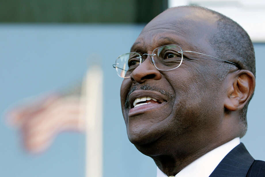 Republican presidential candidate, businessman Herman Cain speaks with the media after a interview on NBC's Meet the Press at NBC studio in Washington on Sunday, Oct. 16, 2011. (AP Photo/Jose Luis Magana) Photo: Jose Luis Magana / FR159526 AP