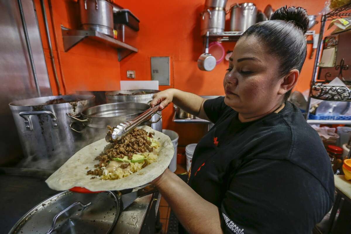 Jackie Gallegos prepares the Pablo Escobar beef burrito at Tacos Los Desvelados.