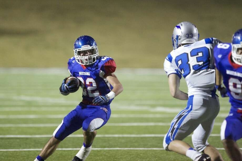 Midland Christian running back Justin Fender runs the ball early in the Mustang's 48-7 win over Dallas Christian in the TAPPS Division II State Semi-final game at Shotwell Field in Abilene Saturday evening. photo by Gary Rhodes Photo: Gary Rhodes