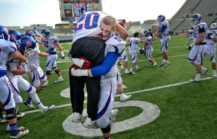 Midland Christian's Bryson Taylor and Christian Whigham celebrate after beating Houston Northland 14-7 to win the TAPPS Division II State Championship game last Saturday at Floyd Casey Stadium in Waco. James Durbin/Reporter-Telegram Photo: JAMES DURBIN