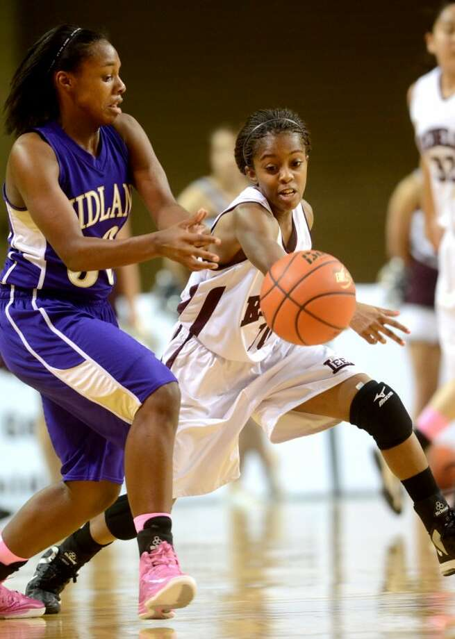 Lee's Daija Stanford gets a steal against Midland Tuesday at the Chaparral Center. James Durbin/Reporter-Telegram Photo: JAMES DURBIN