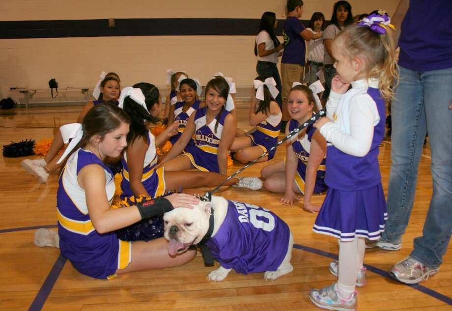 Midland Freshman cheerleaders put Cadet Friday at the Bulldog Beauty Contest to pick their class mascot.