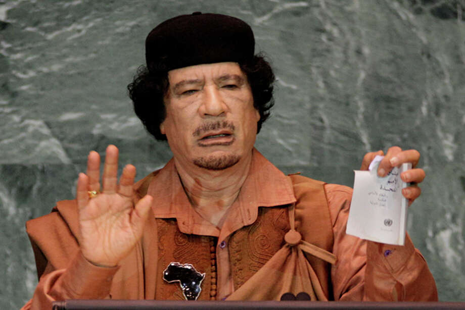 FILE - In this Sept. 23, 2009 photo, Libyan leader Moammar Gadhafi shows a torn copy of the UN Charter during his address to the 64th session of the United Nations General Assembly. A U.S. official says Libya's new government has told the United States that Moammar Gadhafi is dead. The official said Libya's Transitional National Council informed U.S. officials in Libya of the development Thursday, Oct. 20, 2011. (AP Photo/Richard Drew) Photo: Associated Press