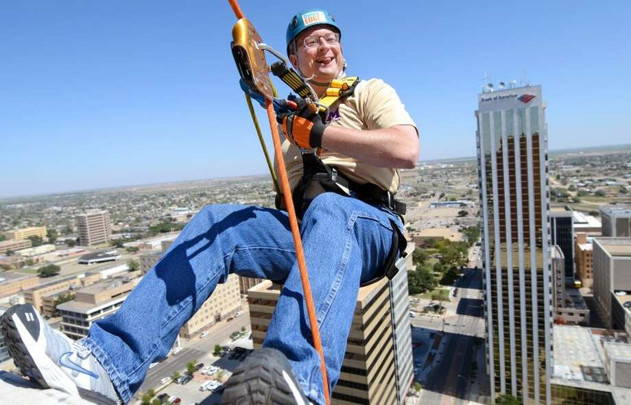 Ryder Warren, MISD Superintendent, rappels over the edge of the Wilco Building as part of the Boy Scouts fundraiser 'Over The Edge.' James Durbin/Reporter-Telegram Photo: JAMES DURBIN
