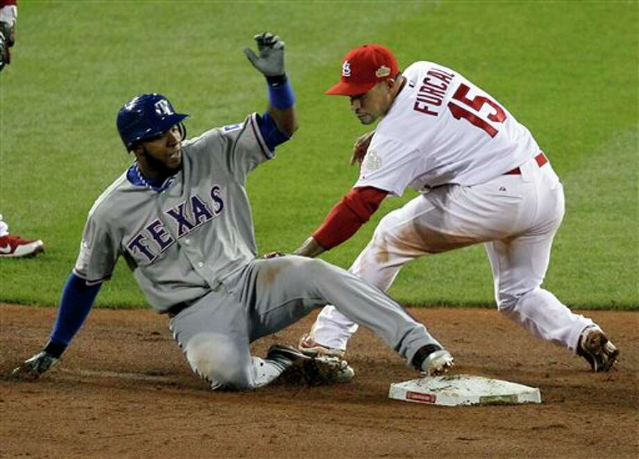 Texas Rangers' Elvis Andrus slides into second beating the tag by St. Louis Cardinals' Rafael Furcal during the ninth inning of Game 2 of baseball's World Series Thursday, Oct. 20, 2011, in St. Louis. (AP Photo/Jeff Roberson) Photo: Jeff Roberson / AP