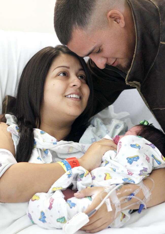 Elizabeth and Erazmo Talamantes hold their newborn baby Eniyah Elizabeth Talamantes, who was born at 12:58 p.m. Wednesday in Midland, making her birthday 12/12/12. James Durbin/Reporter-Telegram Photo: JAMES DURBIN