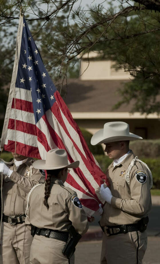 Members of the Midland County Sheriff Honor Guard raise the flag duiring the Honor Our Veterans ceremony at Manor Park for Memorial Day activities. Tim Fischer\Reporter-Telegram Photo: Tim Fischer