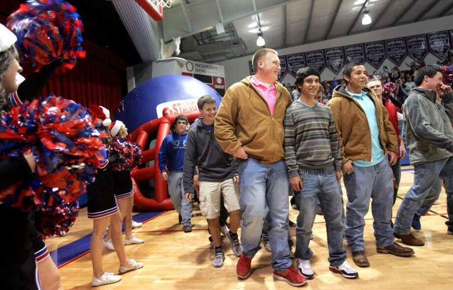 Midland Christian football players enter a pep rally held Wednesday to celebrate the State Championship football win. James Durbin/Reporter-Telegram Photo: JAMES DURBIN