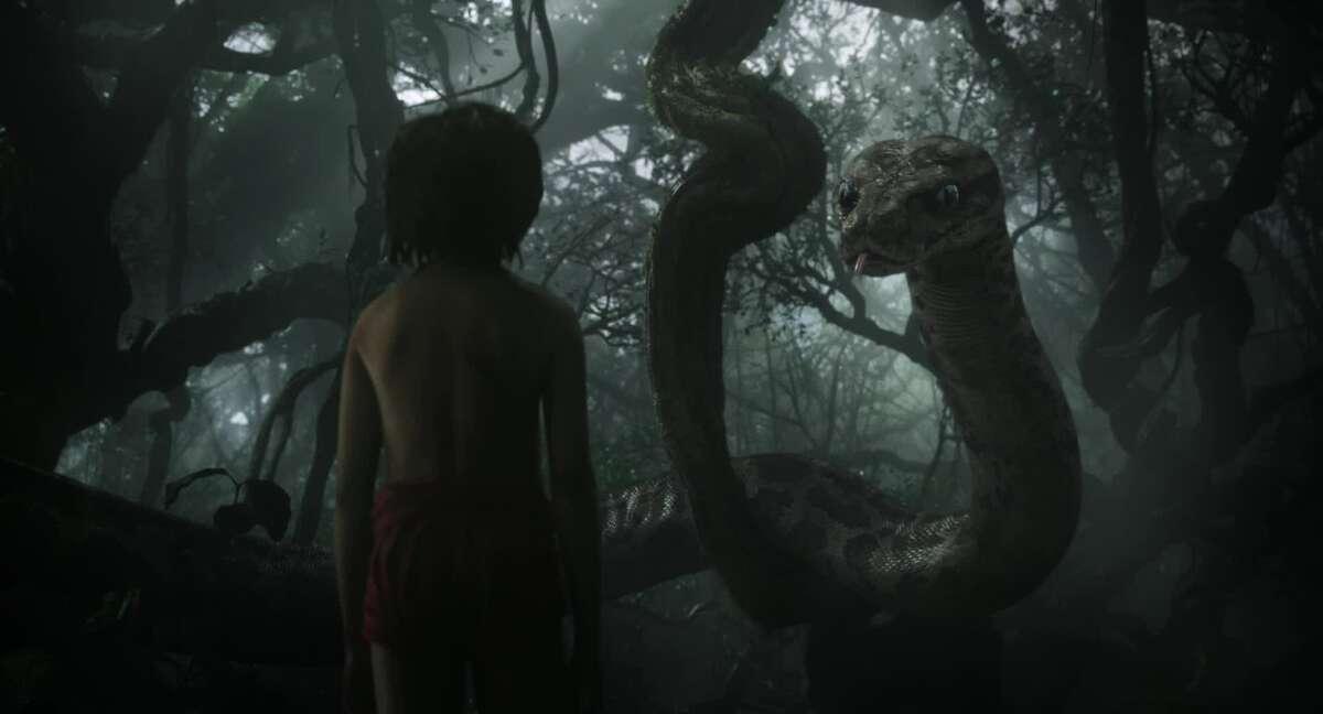 Scarlett Johansson as Kaa and Neel Sethi as Mowgili in