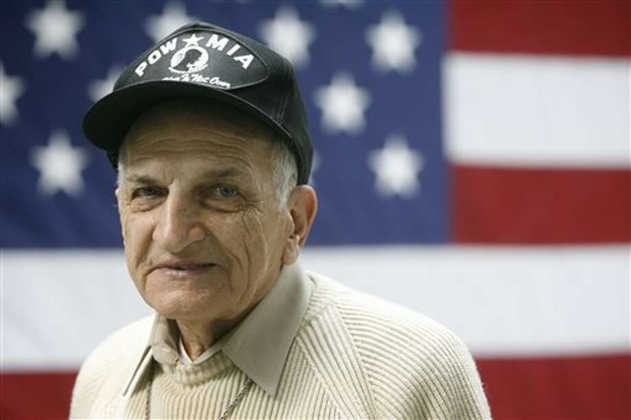 This April 9, 2007 photo shows veteran Bernard Adamski in Buffalo, N.Y. Adamski, an Army Air Corps radio operator and turret gunner in World War II, was captured by the Germans on July 12, 1944, after his B-26 bomber was shot down. The next 10 months were a constant fight for survival: First, the Stalag Luft IV prison camp in what is now Poland. Next, a forced three-month march of more than 600 miles, in the cold during which he used his Polish-speaking ability to ask for loaves of bread. Then, Bergen-Belsen concentration camp, where bodies were stacked high. Weeks later, another march. Finally, liberation by the British on May 2, 1945. Photo: Associated Press / The Buffalo News