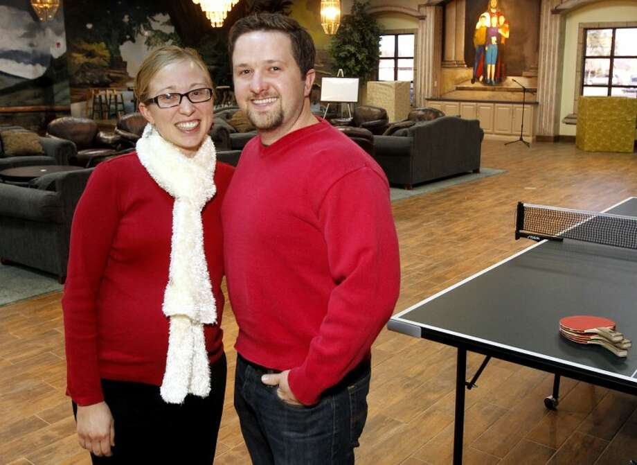 Jordan and Trish Matchen, directors of youth ministry at St. Stephen's Catholic Church, stand in the new youth building at the church Tuesday. James Durbin/Reporter-Telegram Photo: JAMES DURBIN