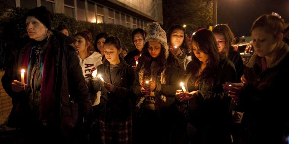 Midlanders come together outside MISD Administration Building Friday night for a candle light vigil for the families and victims in the Connecticut shooting. Tim Fischer\Reporter-Telegram Photo: Tim Fischer