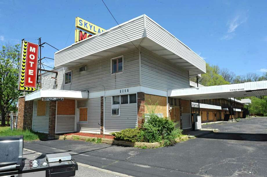 Exterior of the Skylane Motel at 1927 Central Ave. on Tuesday, May 10, 2016 in Colonie, N.Y. The town of Colonie sent its final approval Monday of a project to replace the Skylane Motel, clearing one of the final hurdles for the building to be demolished more than two years after it was closed down. (Lori Van Buren / Times Union) Photo: Lori Van Buren / 20036549A