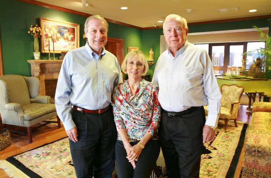 Bert Johnson, from left, his sister Karen Scharbauer, and their dad Ted C. Johnson are in the living room of the home where they once lived before leasing it to Hospice Midland in 1983 and then donating the residence to the organization in 1997. Cindeka Nealy/Reporter-Telegram Photo: Cindeka Nealy