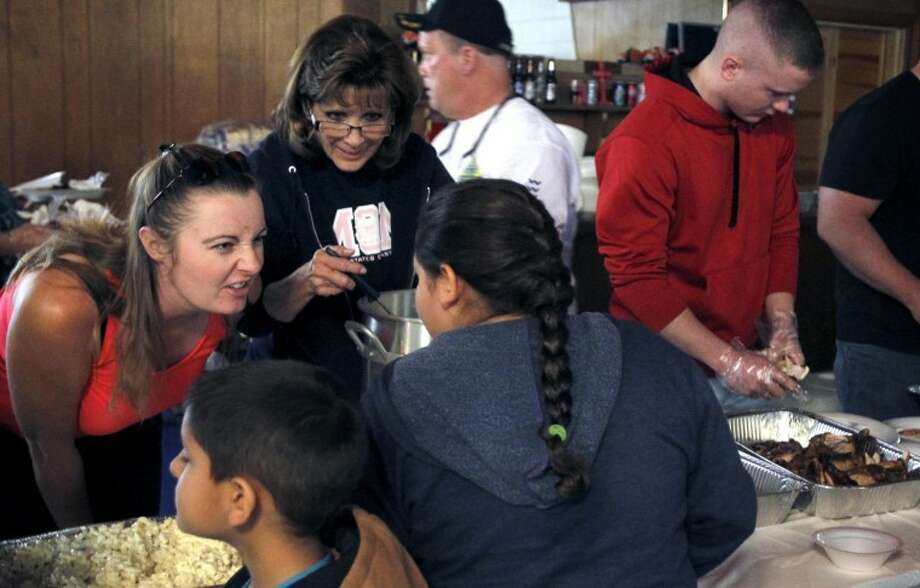 Volunteers serve food during an event hosted by the Patriot Guard Riders and VFW Post 4149 to benefit the families involved in the fatal Nov. 15, 2012 parade accident Saturday at the VFW Post. James Durbin/Reporter-Telegram Photo: JAMES DURBIN