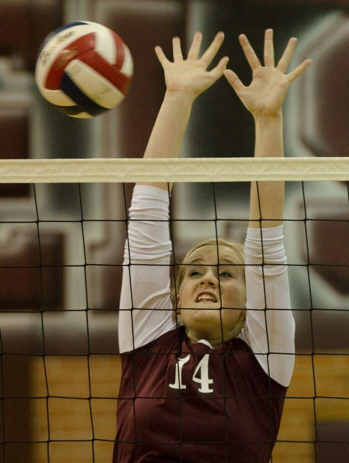 Lee High's Emily Hardaway block the ball Tuesday against Odessa Permian. Photo: Tim Fischer