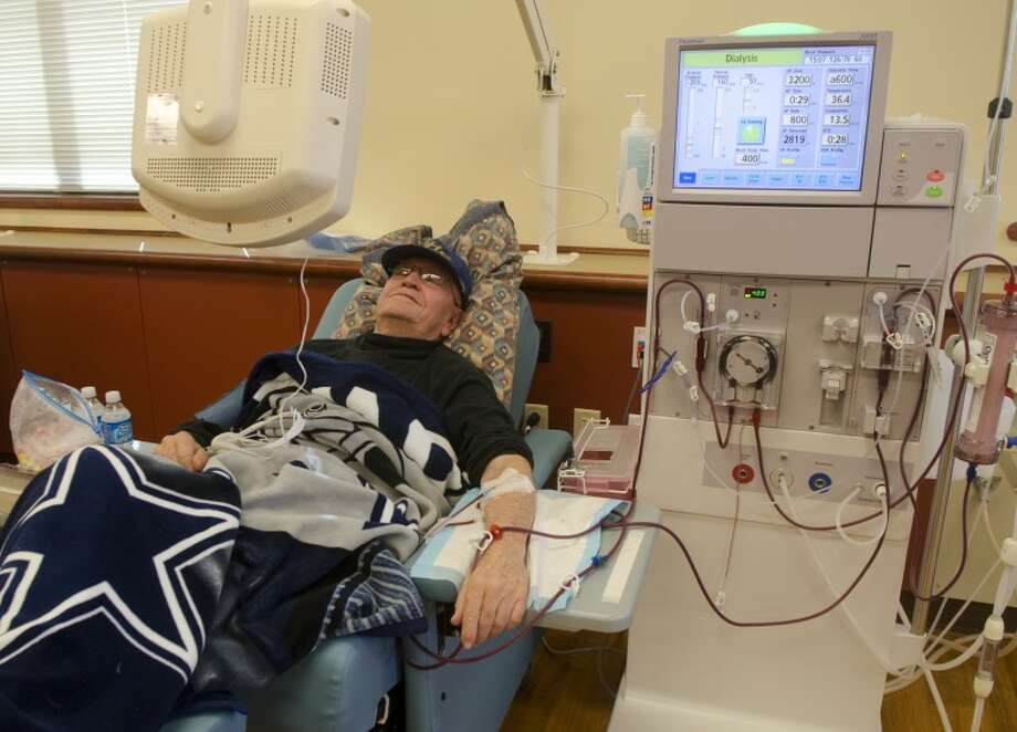 Ed King relaxes watching a movie while getting dialysis in the newly opened Permian Basin Dialysis center at the corner of Golf Course Road and Midkiff Road. Photo by Tim Fischer/Midland Reporter-Telegram Photo: Tim Fischer