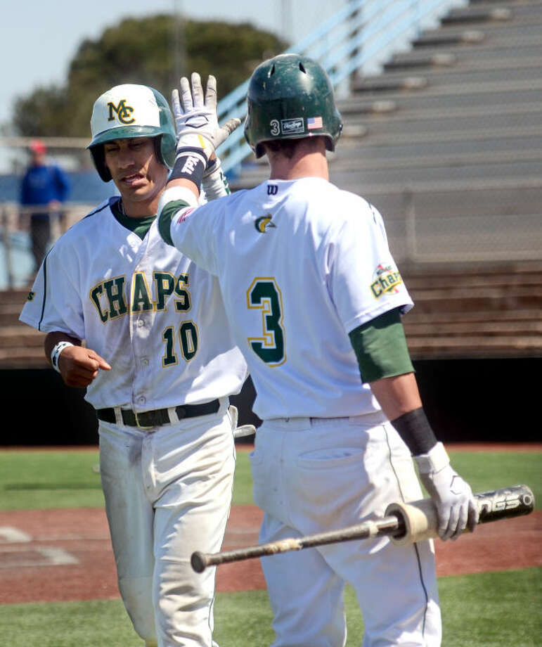 Midland College's Matt Reyes (10) gets a high-five from teammate Blair Beck (3) after scoring a run against Clarendon Friday at Christensen Stadium. James Durbin/Reporter-Telegram Photo: JAMES DURBIN
