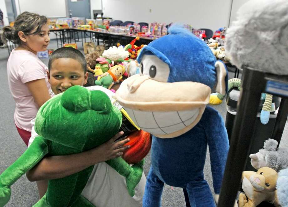 "Juan Samaniego, age 9, picks out the biggest stuffed animals he can find out of the items collected as part of the ""Toys For Cops"" program Tuesday at the Midland County Sheriff's Office. James Durbin/Reporter-Telegram Photo: JAMES DURBIN"