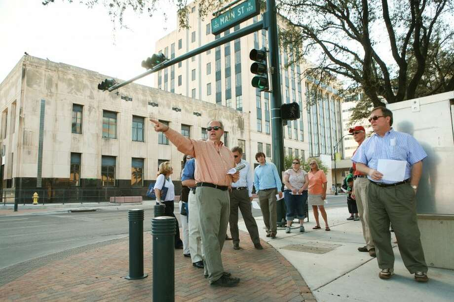 Mark Wellen leads a group of around 20 on a tour that highlights some of the historic mid-century to modern architecture designs of buildings, Oct. 25, 2011 during the city of Midland and Texas Historic Commission downtown walking tour. Photo: Cindeka Nealy/Reporter-Telegram