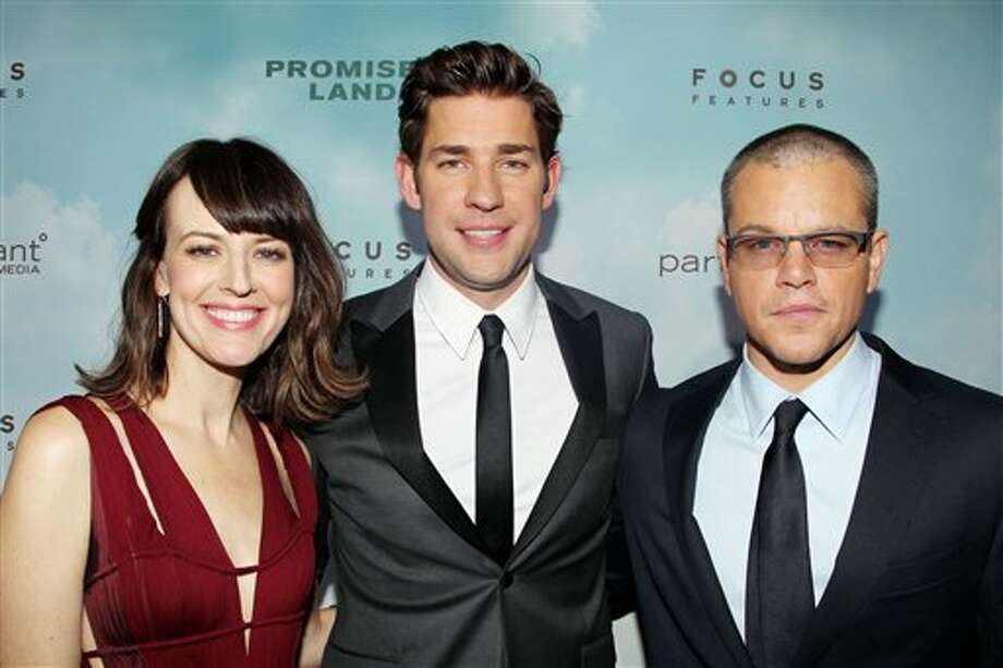 "This Dec. 4, 2012 photo released by Starpix shows actors, from left, Rosemarie DeWitt, John Krasinski, and Matt Damon at the premiere of Focus Features film, "" Promised Land,"" in New York. The film, about a salesman for a natural gas company, was written by Damon and Krasinski and produced and directed by Gus Van Sant. (AP Photo/Starpix, Dave Allocca) Photo: Dave Allocca / STARPIX"