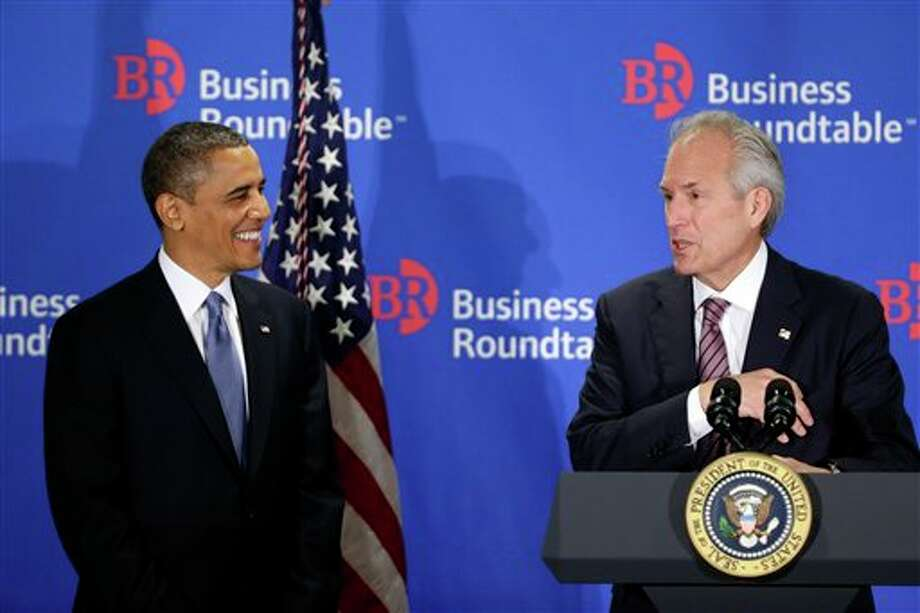 "President Barack Obama is introduced by Jim McNerney, chief executive officer of The Boeing Company, before speaking about the fiscal cliff during an addresses before the Business Roundtable, an association of chief executive officers, Wednesday, Dec. 5, 2012, in Washington. The president warned Republicans not to create another fight over the nation's debt ceiling, telling business leaders it's ""not a game that I will play."" (AP Photo/Charles Dharapak) Photo: Charles Dharapak / AP"