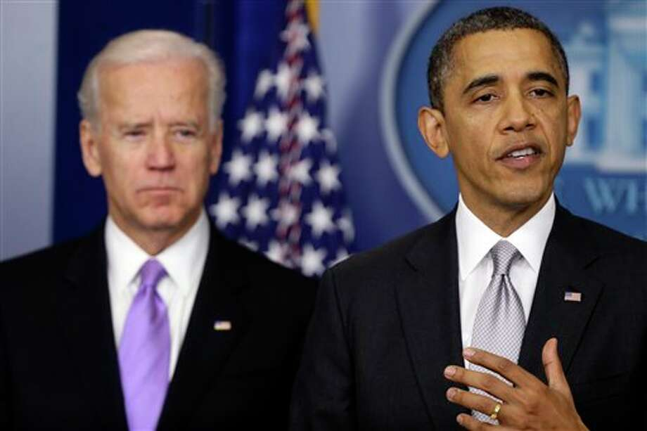 President Barack Obama stands with Vice President Joe Biden as he makes a statement Wednesday, Dec. 19, 2012, in the Brady Press Briefing Room at the White House in Washington, about policies he will pursue following the massacre at Sandy Hook Elementary School in Newtown, Ct. Obama is tasking Vice President Joe Biden, a longtime gun control advocate, with spearheading the effort. (AP Photo/Charles Dharapak) Photo: Charles Dharapak / AP