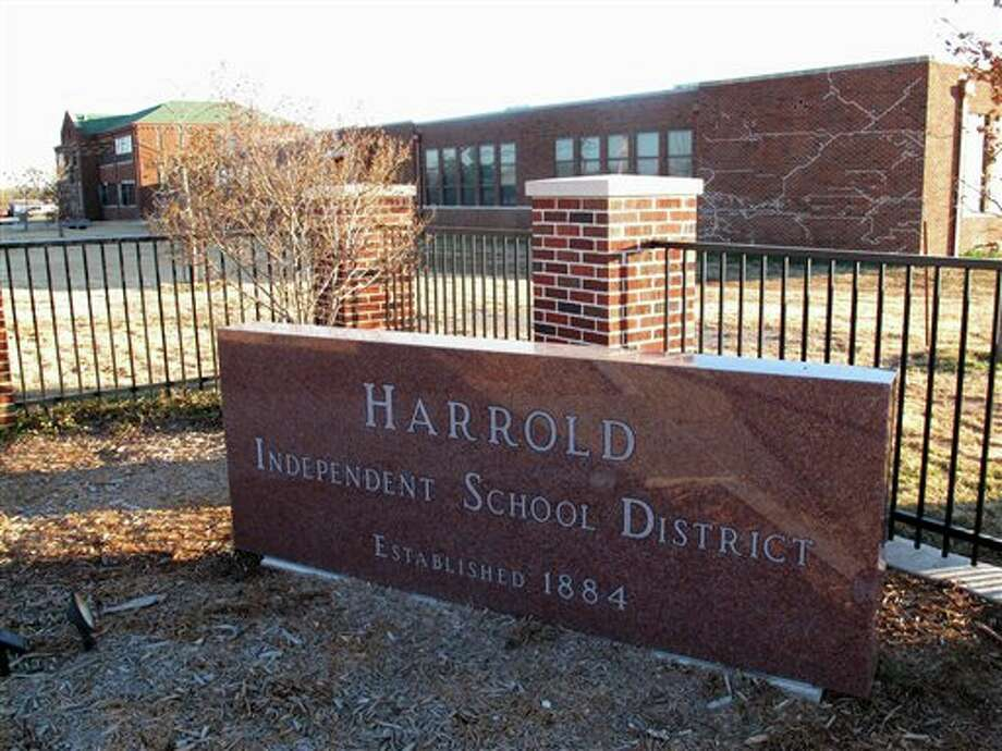 This Monday, Dec. 17, 2012 photo shows the sign in front of the Harrold Independent School District in Harrold, Texas. The K-12 school has a policy allowing teachers and other school employees to carry concealed weapons, a controversial policy that's now being considered in at least five other states in the wake of last week's deadly elementary school shooting in Newtown, Conn. (AP Photo/Angela K. Brown) Photo: Angela K. Brown / AP2012